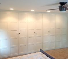 """Ikea Pax Wardrobe Wall - I think the Pax will be too deep at 24"""" but maybe the Hemnes at 14 5/8""""with the half glass, half panel doors would work."""