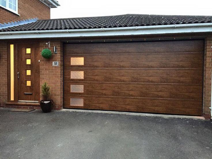 Alutech sectional garage door in golden oak with windows down one ...