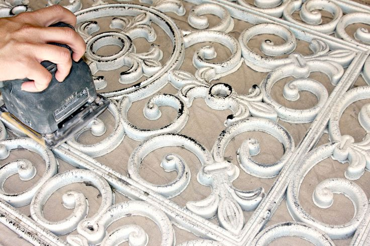 Rubber Door Mat Wall Art {DIY} looks like cast iron, but a lot easier to hang!