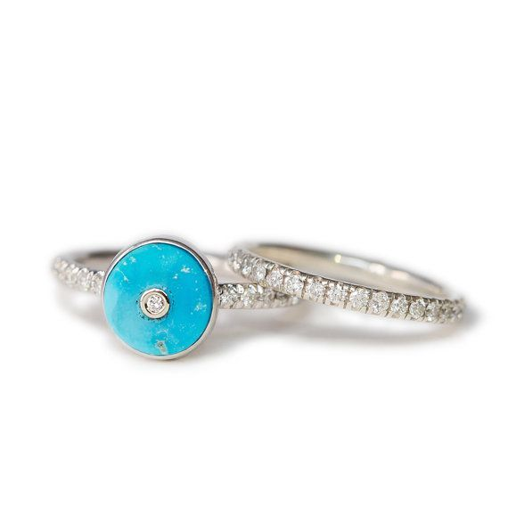 This Webster Stone one-of-a-kind engagement ring is made with a bright true-blue Arizona Turquoise round stone set in .925 sterling silver with a beautiful 14k white gold bezel VS2 quality diamond and 10 sparkling VS2 quality diamonds on the pave band. Each ring is made to order.  Diamonds - total carat weight - 0.12, VS clarity, non conflict 10 x 1mm VS diamonds 1 x 2mm VS diamond set in the middle of beautiful Arizona turquoise  Each piece is hand made with love in New York City, using…