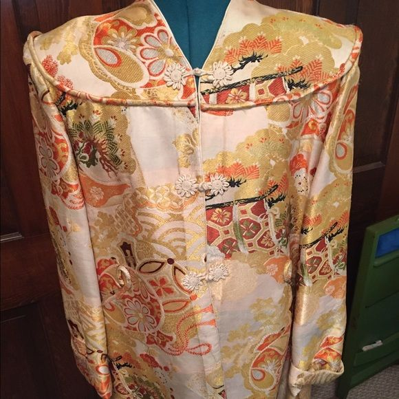 """Long Vintage Silk Jacket This is a truly unique vintage jacket. The size is not listed but the shoulders measure at 16 3/4"""" the jacket is a nice cream color with orange and gold designs. The neckline is unique to this style jacket and the shoulder pads add to the silhouette. Jackets & Coats Blazers"""