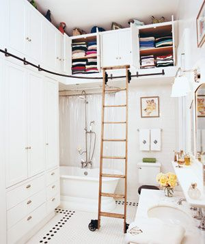 I have always wanted a library with one of these ladders, but I feel like I'd have to have a house-with-secret-passageways kinda place in order to warrant that. I'm not sure how I feel about it here in the bathroom, but I think I dislike it...