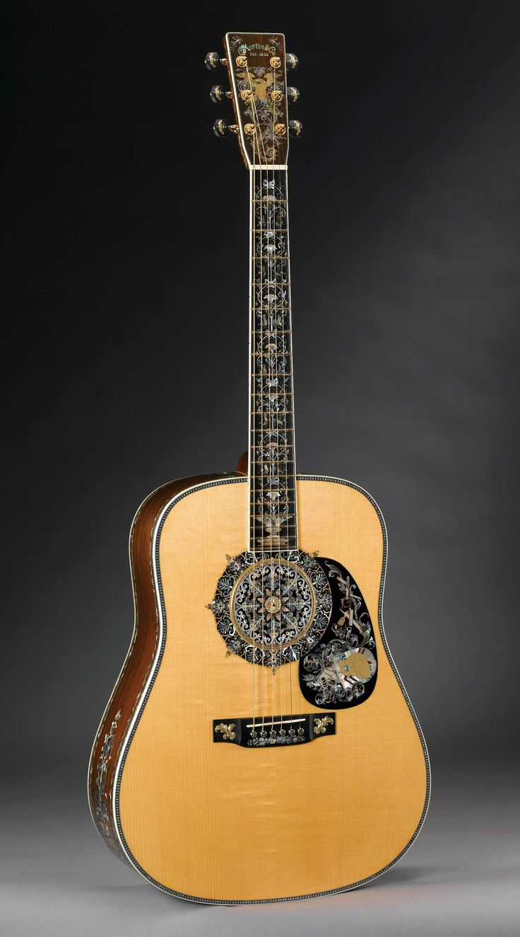 The Martin one millionth guitar. No words can explain the beauty of this guitar