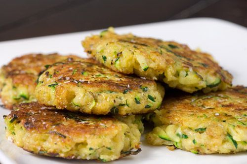 Zucchini Cakes. Freshly shredded zucchini with Parmesan cheese, garlic and spices, pan fried until golden brown.