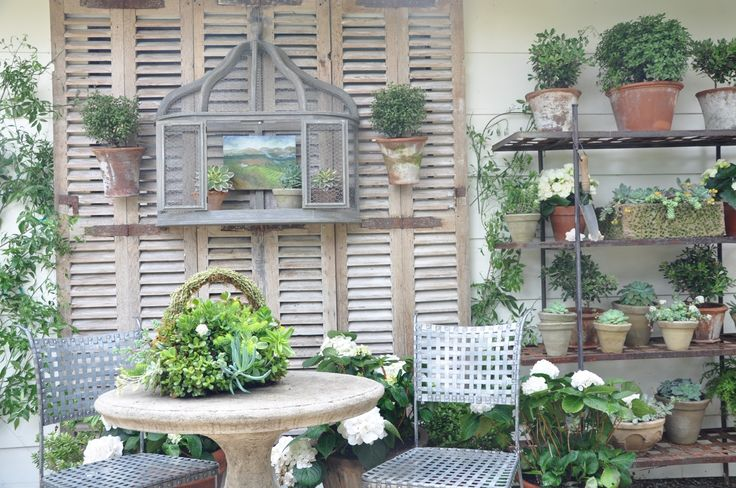 Great idea on the shutters over back window and add some green to a non covered back porch