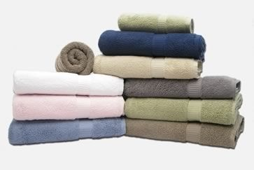 Adding white vinegar to the rinse cycle will break down and remove chemical build up in towels. As your towels reach the rinse cycle, add 1/2 cup white vinegar to the wash. Residual vinegar odor is unlikely, but can be removed by rewashing the towels without detergent or chemicals.  REPEAT AS NEEDED