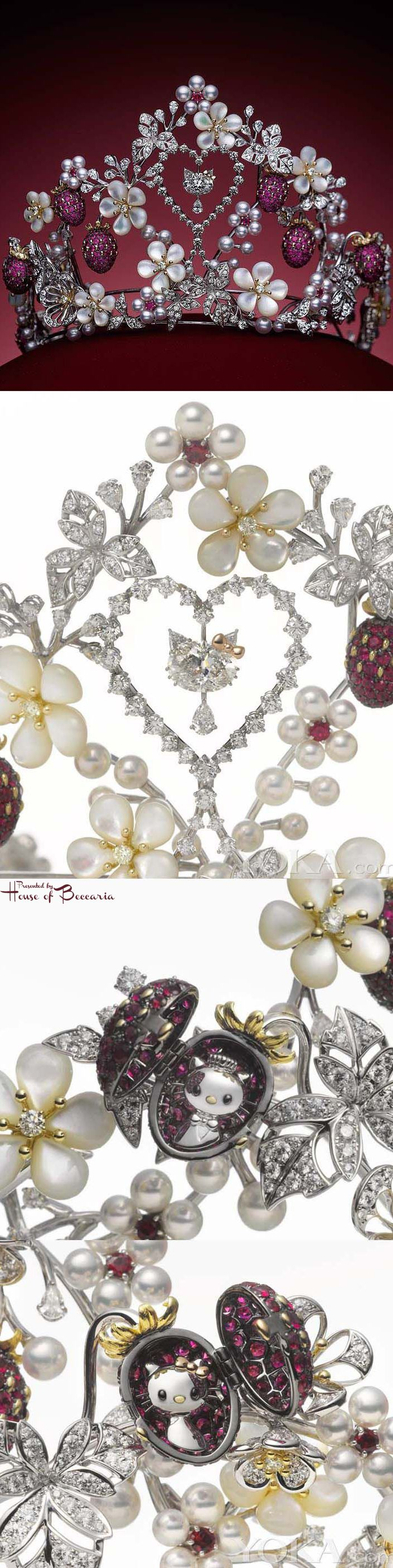 ~Mikimoto Hello Kitty tiara with strawberry motifs of rubies and flowers, designed with mother of pearls. The piece will not be for sale. The two strawberries decorating the sides of the tiara can be opened to reveal Hello Kitty and her boyfriend Daniel hidden inside. Twinkling in the center of the 3D piece is the iconic cat – with an oval-cut diamond for her face, claws for the whiskers and a pair of brilliant-cut diamonds for ears | House of Beccaria
