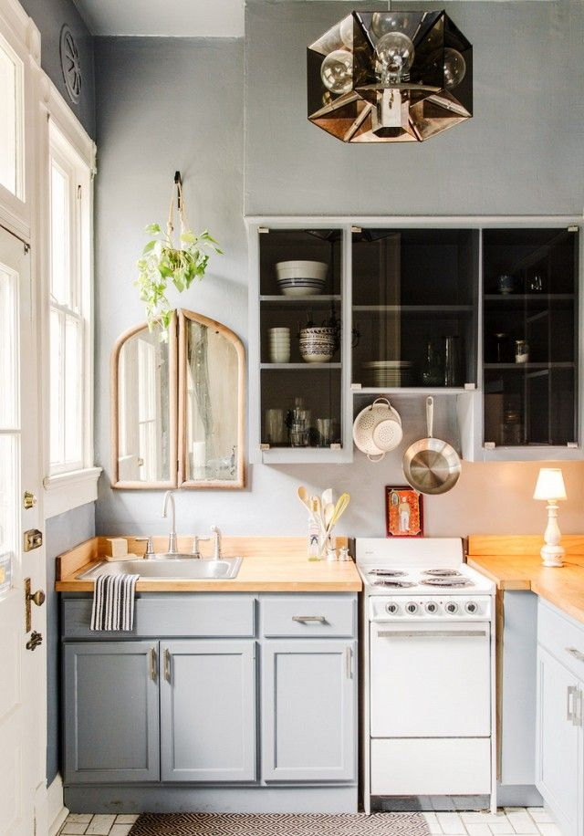 The soft powdery blue gray cabinets and light