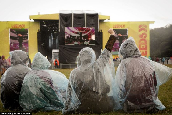 Rain didn't stop these festival-goers from enjoying the music in the main arena at Leeds F...