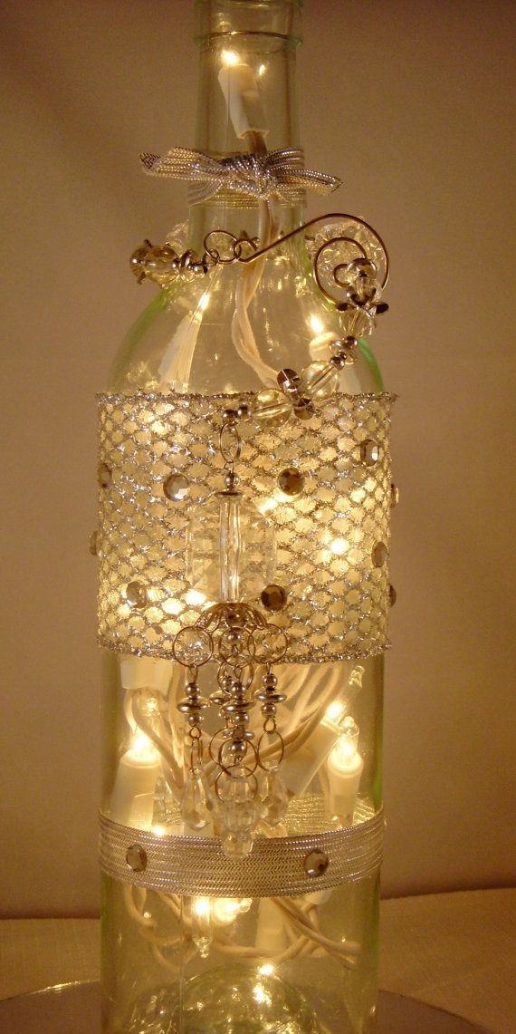 Best 222 wine bottle lights images on pinterest diy and for Glass bottles with lights in them