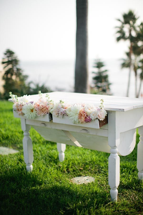 Love this idea with the flowers in the drawers of the cake table.