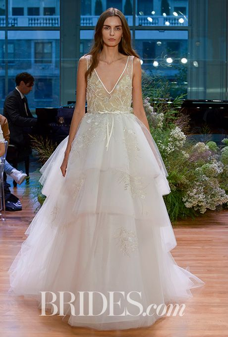 """Brides.com: . """"Carnegie,"""" silk white floral embroidered illusion v-neck ballgown with tiered tulle skirt by Monique Lhuillier"""