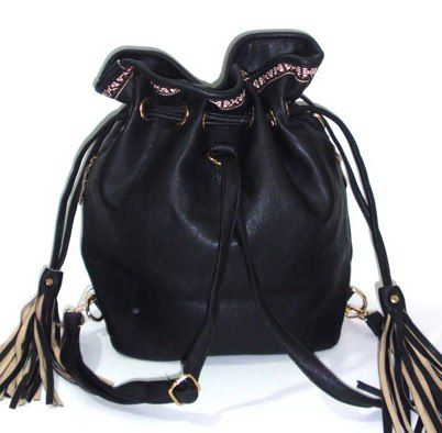Black duffel bag  and backpack with two side tassels and a fabric lace detail on the top, also two side pockets._fashion woman accessories.
