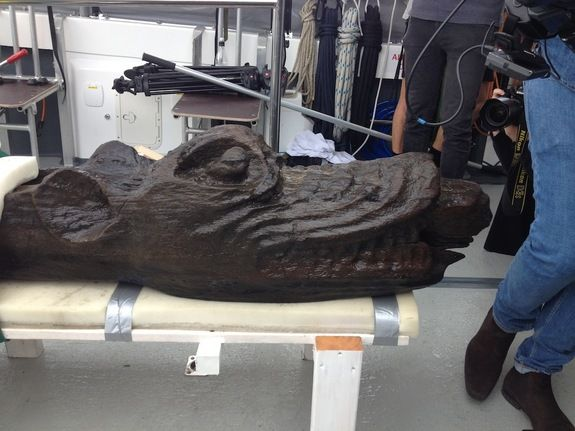 """shiphead of the sunken ship Gribshunden, or """"Grip Dog,"""" sank in 1495 The monstrous figurehead weighs about 660 pounds (300 kg) and from the tip of its nose to its end, it is 11.1 feet (3.4 m) long. Now that it is out of the ocean, the team is soaking it in water while looking for the best way to preserve it. They eventually hope to display it at the Blekinge Museum in Karlskrona, Sweden. (Photo credit: Blekinge Museum)"""