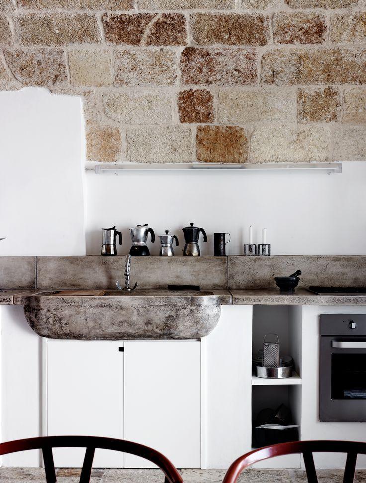 An Italian Kitchen. Stone, concrete and whiteness.