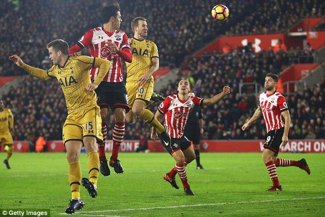 Harry Kane leaps into the air and powers a header at goal to put Spurs ahead against the Saints