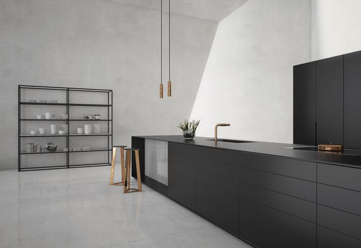 12mm from piqu a contemporary kitchen in dark grey lacquer units and tall units, engineered stone worksurfaces and back painting glass all in 12mm thickness to integrate perfectly. Elegant, clean and beautiful.