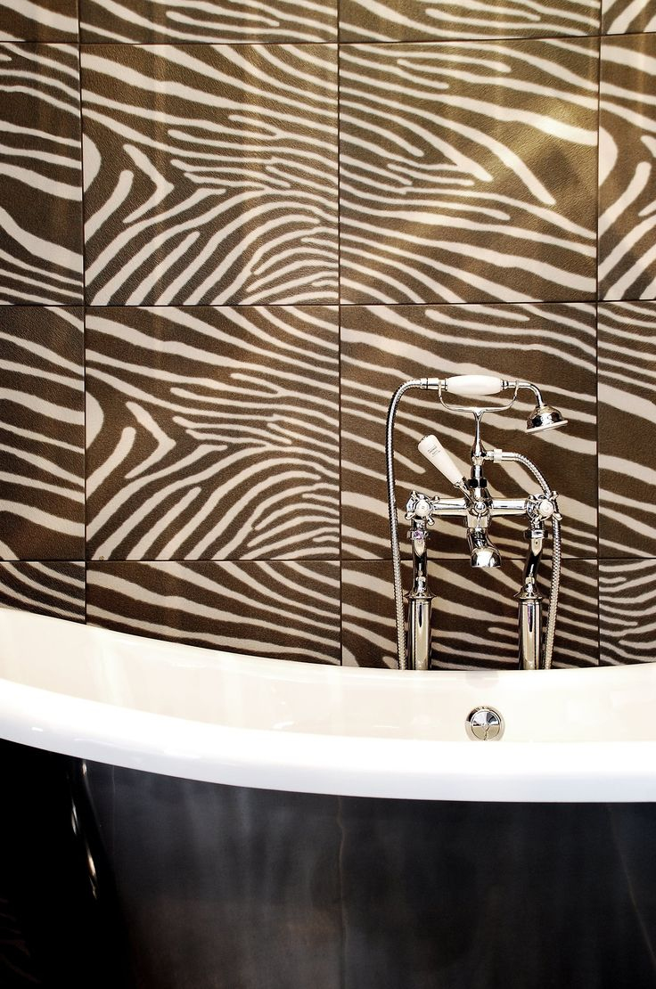 Cavallino Zebra porcelain tiles add a bit of drama wherever they are used! Vibrant animal magnetism with an on trend monochrome palette is a winning combination. From Original Style's Tileworks collection. originalstyle.com