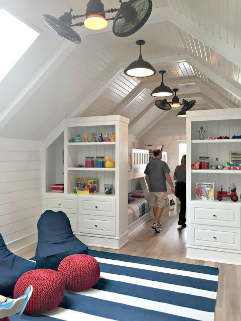 Perfect seating/media/play area with storage and then sleeping quarters in the boys loft attic space. Love the lighting and fans as well.