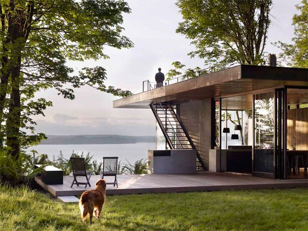 Case Inlet residence designed by MW Works Architects. Nestled into a forested slope along the eastern edge of the Case Inlet, the house has a stunning view of the Olympic mountains in western Washington.