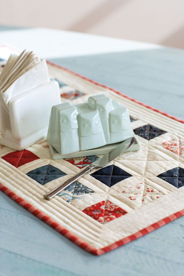 """Do you have a package of 2½"""" squares? Simply add sashing, borders, and binding to make this table topper in just one day. Look for Little Morsels in Fall Scrap '14."""
