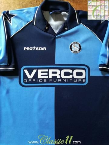 Relive Wycombe Wanderers' 2001/2002 season with this original Pro Star home football shirt.