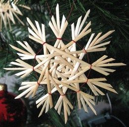 A cute little ornament made with cane or maybe reed (can't quite tell) and what looks like waxed linen.