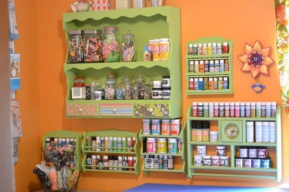 Craft paint storage - love her wall shelves - so cute and
