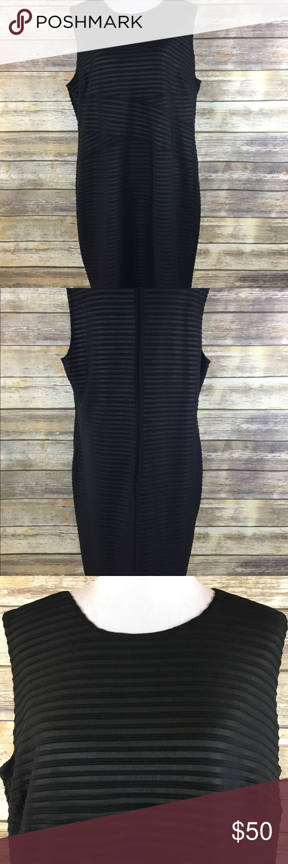 Calvin Klein women's plus size black dress 20 Calvin Klein women's plus size dress. Size 20. Black with nude lining. Black on nude striped detail. Sleeveless. Knee length. Formal, career, little black dress. Armpit to armpit measures about 24 inches. Length is about 39 inches. Calvin Klein Dresses