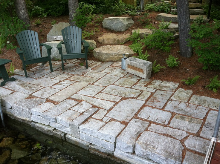 seawall and permeable patio constructed with reclaimed granite - Permeable Patio Ideas