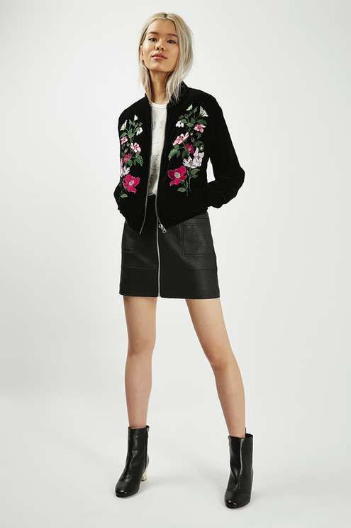 Revive your outerwear for the season change with this embroidered velvet bomber jacket. This on-trend urban look is softened with the colourful floral detailing.