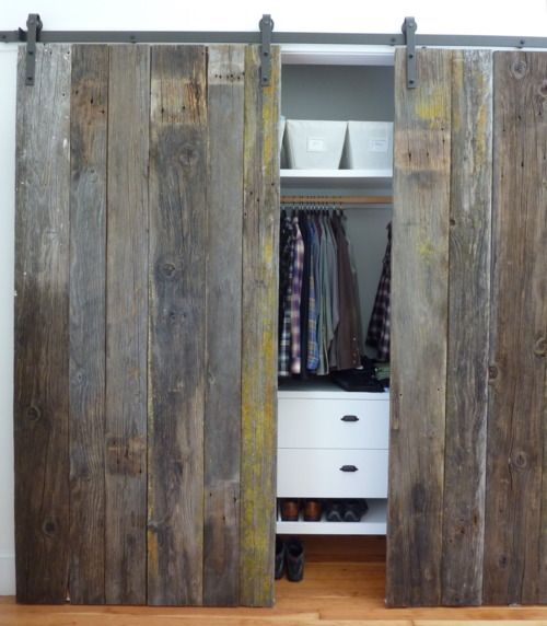 Rustic wood barn doors to cover closet.