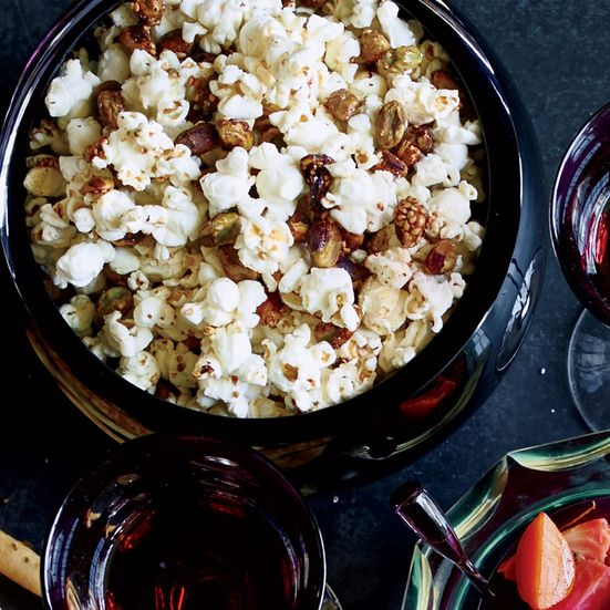 Mixing popcorn with glazed pistachios creates a sweet-salty snack that's fantastic with cocktails.  Slideshow: More Bar Snack Recipes ...