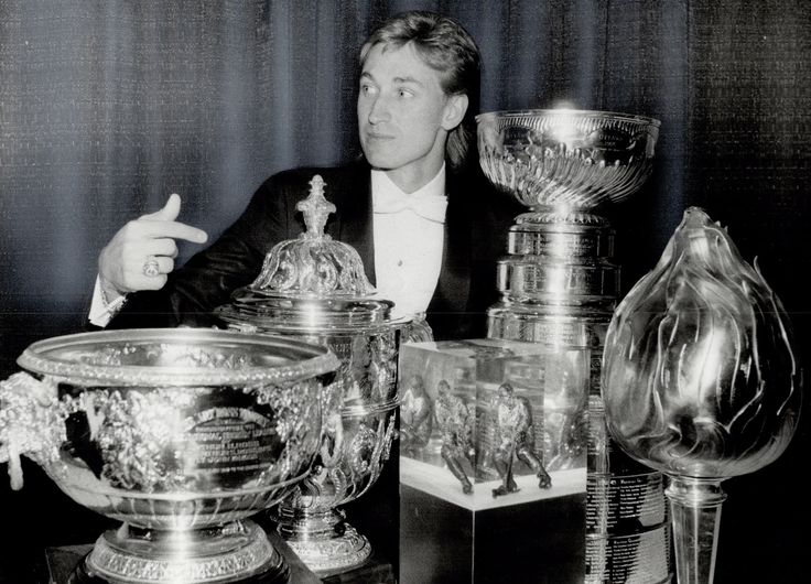 """Can I keep these?"" Wayne Gretzky shows off his hardware for the season. From l to r: Art Ross, Campbell Bowl, Pearson Award, Lord Stanley's Cup and Hart Trophy."