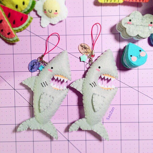 Shipping these two [baby great white #shark] plushie cellphone charms off to their new homes... ✂️✨ Available as a made to order item in my #etsy shop!