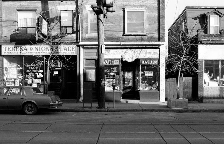 760 Dundas St W, photographed February 28, 1988, when Eugene's Jewellery was still in business, with the clock in place over the entrance ...