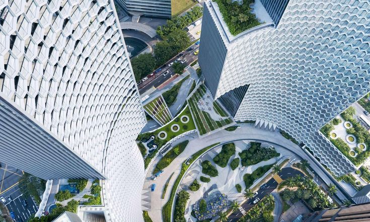 Ole Scheeren postavil vSingapuru dvojici mrakodrapů sfasádami zpláství
