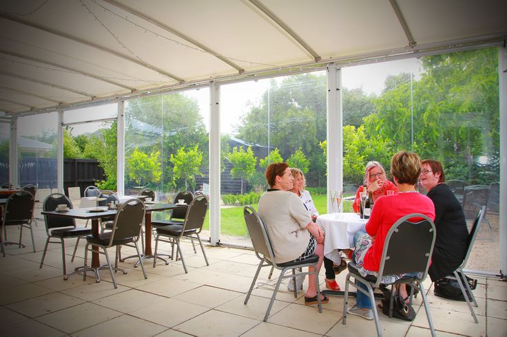 Our outside conservatory area,  Perfect for a warm day but sheltered also