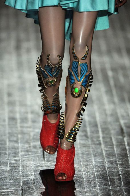 This is an Indian designer who presented at Paris in 2013. His stuff is incredible - details, just from a world that is definitely exquisite, ornate, dowsed in hues we dip our toes into when feeling saucy. look at the whole collection. im just going to give you this superhero lady leg for now. manish arora f11