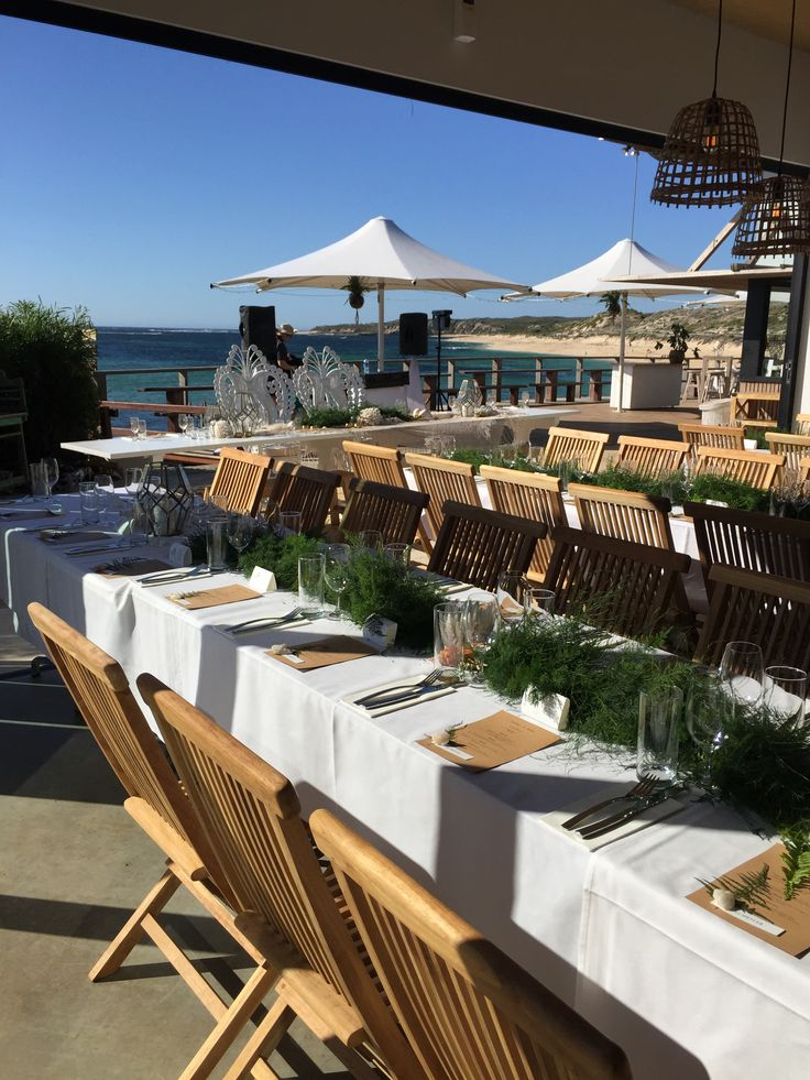 A restaurant sit down set up, the bifold's fully open bring the outside in and leave the deck for party space! Timber folding chairs from Empire Events.