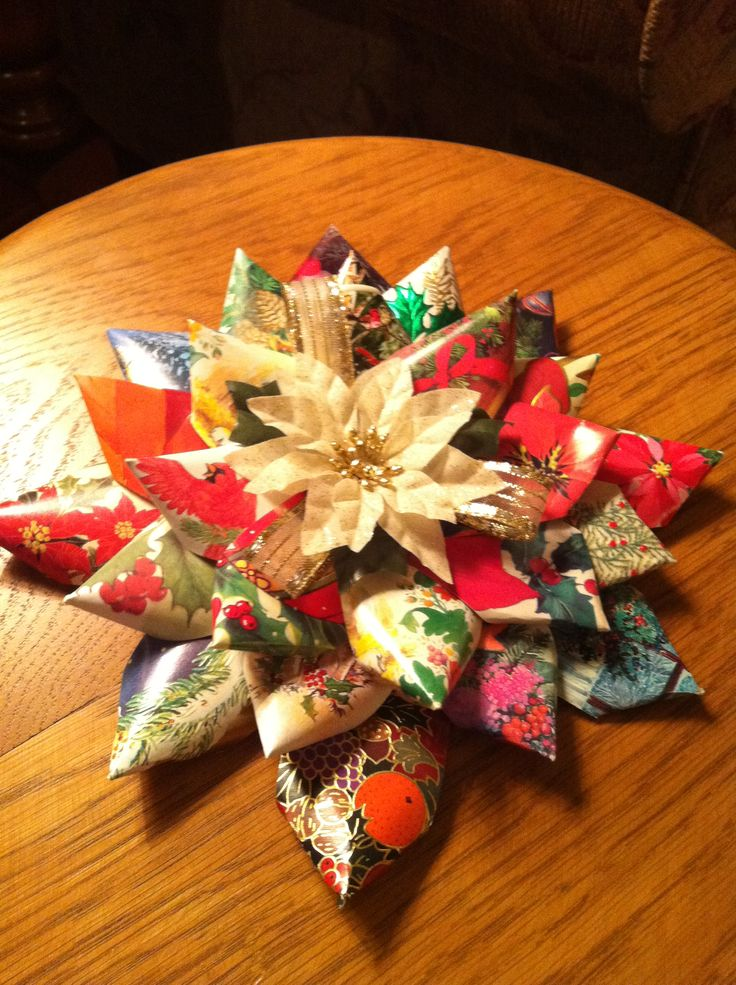 Use old christmas cards to make an easy Christmas paper poinsettia