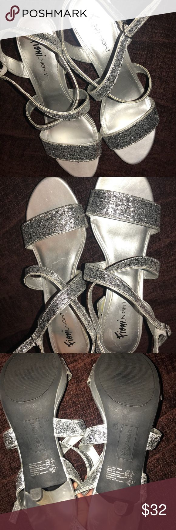 Silver Sparkly Heels Silver sparkly heels. Size 10. Worn once.  🌟I ship same day if purchased before 4 pm 🌟Smoke/pet free home 🌟Open to trades 🌟Open to offers FIONI Night Shoes Heels