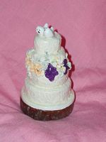 CUSTOM MINI WEDDING CAKE REPLICA ORNAMENTS/ STATUES/JEWELRY We specialize in re-creating and replicating your favorite wedding cake or other special occasion cake into a keepsake miniature statue, ornament or jewelry.