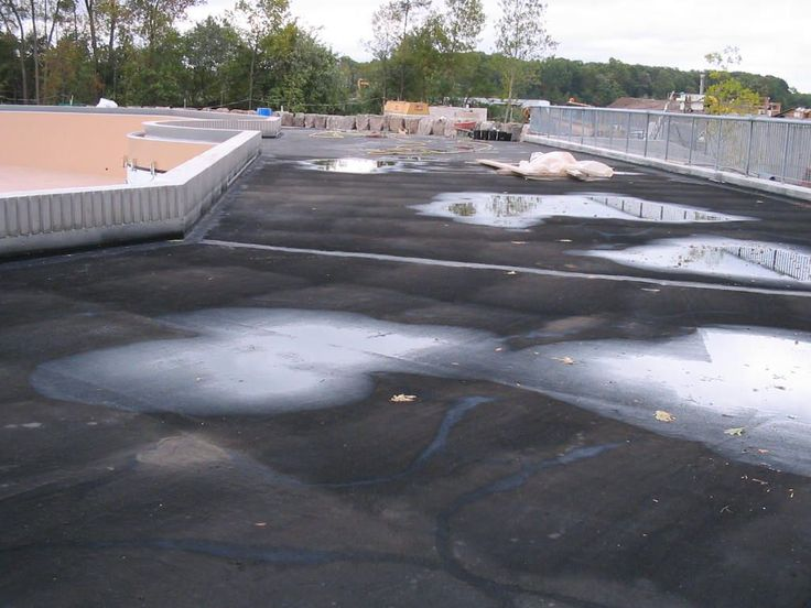SUPERPRO Roof Coating Application provides a permanent waterproof barrier that prevents water from entering the foundation wall. Its highly elastic properties allow for expansion and contraction of the foundation, bridging typical wall cracks with ease. Call 1-800-571-1877 for more information and pricing.