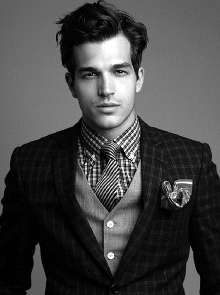 Print mixing done right: striped tie with a checkered shirt and a plaid jacket with a subtle pinstripe waistcoat