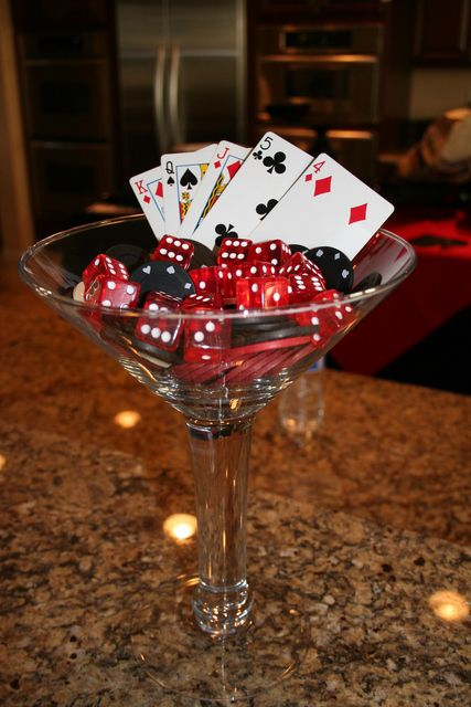 martini glass decor, bacon wrapped food, roulette shot glasses, red carnation topiary, bathroom signs, cards on glasses 40th Casino Party