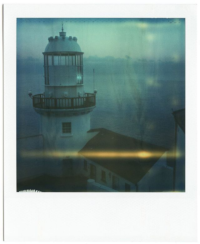 Silent dusk over Wicklow Head lighthouse in Ireland, wonderful place. Old Polaroid pic from my portfolio...