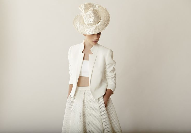 White on white: Hat by Rebecca Share. Top & Skirt by Scanlan Theodore. Blazer by Nicholas. Bracelet by Petite Grand at INCU