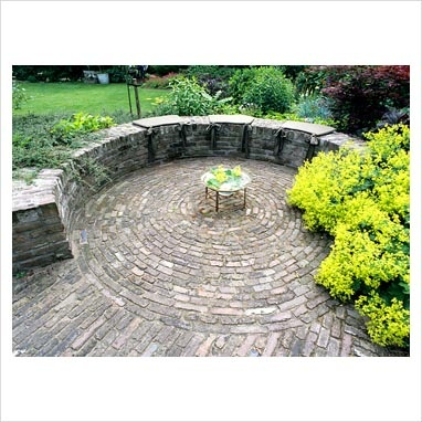 Circular patio with wall and brick paving  (Elke Borlowski photographer)