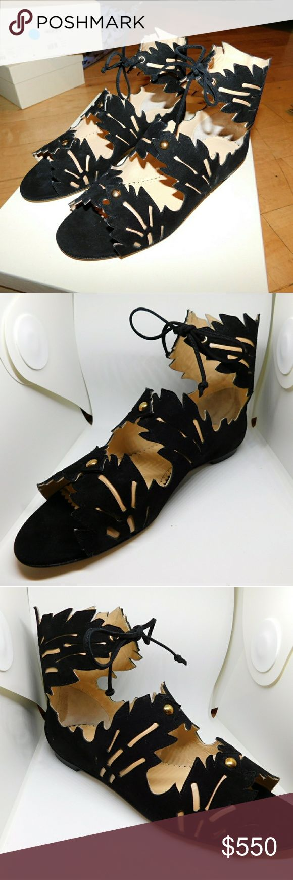 Charlotte Olympia Eden Cutout Suede Sandals EU 36.5 / US 6.5 - MSRP $975  Comes with the box (and 2 shoe bags) or I can ship without it for cheaper.  DETAILS  - Handmade in Italy  - Heel measures approximately 10mm/ 0.5 inch  - Black suede  - Leaf-inspired cutouts, sand leather lining and insole, gold-tone push stud detail, open round toe, signature gold web plaque at sole  - Ankle ties  - Come with an adhesive Polaroid picture which is placed on the outside of your shoe box Charlotte…